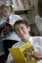 Hanham high school. Pupils reading in the library. - Paul Box - 2000s,2005,adolescence,adolescent,adolescents,book,books,bookshelf,bookshelves,boy,boys,child,CHILDHOOD,children,comprehensive,COMPREHENSIVES,EDU Education,female,females,girl,girls,juvenile,juveniles