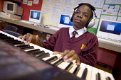 Hanham high school, Bristol. A pupil practices playing keyboard. - Paul Box - 06-12-2005