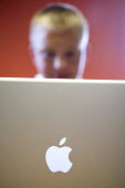 A pupil uses an Apple laptop. - Paul Box - 2000s,2005,adolescence,adolescent,adolescents,aluminium,apple mac,bluetooth,child,CHILDHOOD,children,class,communicating,communication,comprehensive,COMPREHENSIVES,COMPUTE,computer,computers,computing
