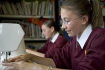 Hanham high school, Bristol. Pupils using sewing machines - Paul Box - 06-12-2005