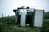 A lorry blown over on the A39 near Porlock after gales sweep the south West. - Paul Box - 2000s,2005,accident,accidental,ACCIDENTS,blown,care,crash,crashed,cross,damage,damaged,dia accident accidents,drive,exposed,force,gale,gales,gusts,HAULAGE,HAULIER,HAULIERS,HGV,hgvs,high,high winds,hig