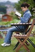 A young woman reading on her allotment. Bristol - Paul Box - 15-12-2005