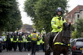 Police escort Bristol City football fans to Bristol Rovers football stadium for a city Derby. - Paul Box - 15-12-2005