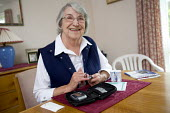An elderly diabetic lady gives her own insulin injection. - Paul Box - 15-12-2005