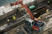 Builders construct a harbour wall at Rosslare Port Ireland. - Paul Box - 20-12-2005