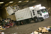 South London, Waste disposal centre. A waste disposal truck reverses into the depot. - Paul Box - 15-12-2005