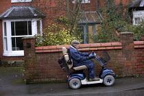 An elderly man on an electric wheelchair. - Paul Box - 07-01-2006