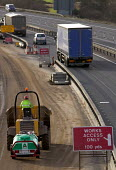 Construction workers on the M5, carrying out motorway maintenance work. - Paul Box - 2000s,2006,access,BUILDING,building site,BUILDINGS,carries,carry,carrying,CLOSED,closing,closure,closures,construction,Construction Industry,driver,DRIVERS,DRIVING,dumper truck,EBF Economy,groundworks