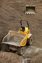Construction work on the rebuilding of Bristol city centre. - Paul Box - 2000s,2006,AGGREGATE,aggregates,bucket,BUILDING,building site,BUILDINGS,City centre,construction,Construction Industry,developer,developers,DEVELOPMENT,digger,DRIVER,DRIVERS,driving,dumper truck,EBF E