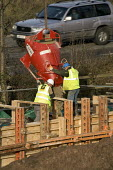 Construction workers on the M5, motorway maintenance work. Pooring concrete - Paul Box - 01-04-2006