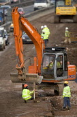 Construction workers on the M5, motorway maintenance work. - Paul Box - 01-04-2006