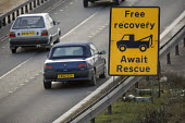 Free breakdown recovery sign on the M5 during motorway maintenance work. - Paul Box - 01-04-2006