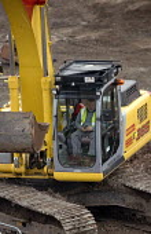Construction work on the rebuilding of Bristol city centre. - Paul Box - 2000s,2006,a,asleep,break,break time,breaktime,BUILDING,building site,BUILDINGS,City centre,construction,Construction Industry,developer,developers,DEVELOPMENT,digger,driver,DRIVERS,DRIVING,dumper,dum