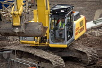Construction work on the rebuilding of Bristol city centre. - Paul Box - 2000s,2006,a,asleep,break,break time,breaktime,BUILDER,builders,BUILDING,building site,BUILDINGS,City centre,construction,Construction Industry,developer,developers,DEVELOPMENT,digger,driver,DRIVERS,D