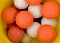 Hockey balls in a bucket in a schools sports ground. - Paul Box - 2000s,2006,ball,balls,EDU Education,game,games,Hockey,school,schools,secondary,spo sport sports,sports