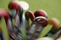 Hockey sticks on an astroturf pitch in a school sports ground.. - Paul Box - 10-06-2006