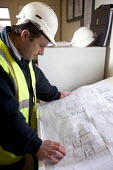 A site foreman studies architects drawings. The site will be for social housing provision. - Paul Box - 10-06-2006