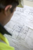 A site foreman studies architects drawings. The site will be a social housing provision. - Paul Box - 10-06-2006