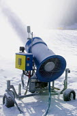 Snowmaking machine , Alps. The machine blows water through a fine mesh which freezes if the temperature is below freezing, producing snow on the pistes for the skiers. - Paul Box - 20-01-2007