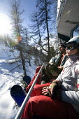 Polish snowboarders on holiday in the French Alps. - Paul Box - 2000s,2007,alpine,alps,ENI Environmental issues,eu,Europe,european,europeans,FEMALE,french,holiday,holiday maker,holiday makers,holidaymaker,holidaymakers,holidays,LFL Lifestyle leisure,people,person,