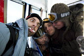 Polish snowboarders having fun in a cable car in the French Alps. - Paul Box - 2000s,2007,alpine,alps,eu,Europe,european,europeans,french,holidays,LFL Lifestyle leisure,male,man,men,people,person,persons,Polish,resort,ski,skiers,skiing,snowboarding,spo sport sports,winter