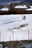 Sainte Foy ski resort, near Val dIsere and Tignes in the French Alps. With unseasonably warm temperatures the snow has been melting leaving mud and rocks showing on the pistes. - Paul Box - 20-01-2007