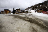 Sainte Foy ski resort, near Val dIsere and Tignes in the French Alps. With unseasonably warm temperatures the snow has been melting, leaving mud, rocks, earth and ice on the pistes. - Paul Box - 2000s,2007,bare,Chalet,Chalets,Climate Change,conditions,depth,EBF Economy,empty,ENI Environmental issues,eu,Europe,european,europeans,french,Glacier,glaciers,Global Warming,holiday,holiday maker,holi