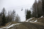 Sainte Foy ski resort, near Val dIsere and Tignes in the French Alps. With unseasonably warm temperatures the snow has been melting, leaving mud, rocks, earth and ice on the pistes. - Paul Box - 2000s,2007,bare,chairlift,Climate Change,closed,closing,closure,closures,conditions,depth,empty,ENI Environmental issues,eu,Europe,european,europeans,french,Glacier,glaciers,Global Warming,holiday,hol