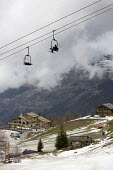 Sainte Foy ski resort, near Val dIsere and Tignes in the French Alps. With unseasonably warm temperatures the snow has been melting, leaving mud, rocks, earth and ice on the pistes. - Paul Box - 20-01-2007