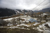 Sainte Foy ski resort, near Val dIsere and Tignes in the French Alps. With unseasonably warm temperatures the snow has been melting, leaving mud, rocks, earth and ice on the pistes. - Paul Box - 2000s,2007,bare,chairlift,Chalet,Chalets,Climate Change,closed,closing,closure,closures,conditions,depth,EBF Economy,empty,ENI Environmental issues,eu,Europe,european,europeans,french,Glacier,glaciers