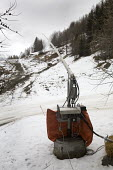 Snowmaking machine , Alps. Although fresh snow is needed the temperature is too warm to use the machine. The machine blows water through a fine mesh which freezes if the temperature is below freezing,... - Paul Box - 20-01-2007