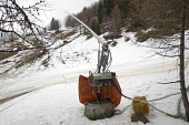 Snowmaking machine , Alps. Although fresh snow is needed the temperature is too warm to use the machine. The machine blows water through a fine mesh which freezes if the temperature is below freezing,... - Paul Box - 2000s,2007,artificial,bare,cannon,cannons,Climate Change,conditions,depth,ENI Environmental issues,eu,Europe,european,europeans,eurozone,fake,fine,france,freezing,french,Glacier,glaciers,Global Warmin