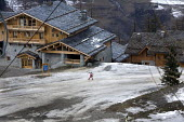Sainte Foy ski resort, near Val dIsere and Tignes in the French Alps. With unseasonably warm temperatures the snow has been melting, leaving mud and rocks showing on the pistes. - Paul Box - 20-01-2007