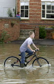 Flooded streets in Shipston On Stour, Warwickshire. - Paul Box - 2000s,2007,BAD,bicycle,bicycles,BICYCLING,Bicyclist,Bicyclists,bike,bikes,boo,boot,boy,boys,child,CHILDHOOD,children,CYCLE,cycles,cycling,cyclist,Cyclists,dia disaster,eni environmental issues,EXTREME