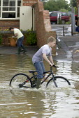Flooded streets in Shipston On Stour, Warwickshire. - Paul Box - 2000s,2007,BAD,bicycle,bicycles,BICYCLING,Bicyclist,Bicyclists,bike,bikes,boo,boot,boy,boys,child,CHILDHOOD,children,cleaning,cleansing,CYCLE,cycles,cycling,cyclist,Cyclists,dia disaster,eni environme