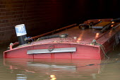 A barge is sunk in the canal by flood waters, Stratford upon avon, Warwickshire. - Paul Box - 21-07-2007
