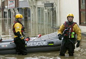 Flooded high street in Evesham, Warwickshire Firefighters patrol the streets looking to rescue trapped residents, Warwickshire. After the river Avon bursts its banks - Paul Box - 2000s,2007,adult,adults,BAD,boat,boats,business,damage,danger,dangerous,DIA,dia disaster,dinghies,dinghy,dingy,dirty water,dry,Emergency Services,eni environmental issues,evacuating,evacuation,EXTREME