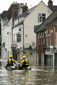 A man looks out on a flooded high street in Evesham, Warwickshire whilst Firefighters patrol the streets looking to rescue trapped residents, Warwickshire. After the river Avon bursts its banks - Paul Box - 22-07-2007