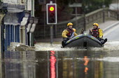 Flooded high street in Evesham, Warwickshire Firefighters patrol the streets looking to rescue trapped residents, Warwickshire. After the river Avon bursts its banks - Paul Box - 2000s,2007,adult,adults,BAD,boat,boats,bow,business,damage,danger,dangerous,DIA,dia disaster,dingy,dirty water,dry,Emergency Services,eni environmental issues,evacuating,evacuation,EXTREME,fire brigad