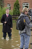 Sky news report from a flooded street, Tewkesbury, Gloucestershire after the river Avon and the river Severn bursts their banks. - Paul Box - 2000s,2007,BAD,boo,boot,broadcast,broadcasting,camera,cameraman,cameras,communicating,communication,damage,damaged,dia disaster,eni environmental issues,EXTREME,filming,flood,Flood Plain,flooded,flood