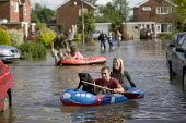 Local residents use dingys to paddle through their flooded estate, Tewkesbury, Gloucestershire after the river Avon and the river Severn bursts their banks. - Paul Box - 22-07-2007