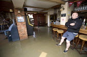 The landlord of The Pen and Parchment pub looks at his flooded pub after the river Avon burst its banks, Stratford upon avon, Warwickshire. - Paul Box - ,2000s,2007,BAD,beer,business,closed,closing,closure,closures,damage,damaged,dia disaster,eni environmental issues,EXTREME,flood,flooded,flooding,floods,level,levels,LICENSED,male,man,men,people,perso