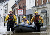 Flooded high street in Evesham, Warwickshire Firefighters patrol the streets looking to rescue trapped residents, Warwickshire. After the river Avon bursts its banks - Paul Box - 2000s,2007,adult,adults,BAD,boat,boats,bow,business,damage,danger,dangerous,DIA,dia disaster,dinghies,dinghy,dingy,dirty water,dry,Emergency Services,eni environmental issues,evacuating,evacuation,EXT
