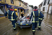 Flooded high street in Evesham, Warwickshire Firefighters patrol the streets looking to rescue trapped residents, Warwickshire. After the river Avon bursts its banks - Paul Box - 2000s,2007,adult,adults,BAD,boat,boats,bow,business,carries,carry,carrying,damage,danger,dangerous,DIA,dia disaster,dinghies,dinghy,dingy,dirty water,dry,Emergency Services,eni environmental issues,ev