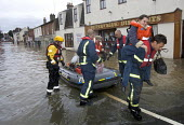 Flooded high street in Evesham, Warwickshire Firefighters rescue trapped residents, Warwickshire. After the river Avon bursts its banks - Paul Box - 2000s,2007,adult,adults,back,BAD,boat,boats,business,carries,carry,carrying,damage,danger,dangerous,DIA,dia disaster,dinghies,dinghy,dingy,dirty water,dry,Emergency Services,eni environmental issues,e