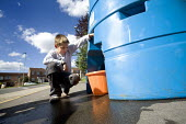 Gloucester, Citizens that have no water supply due to the flooded water works plant in Tewkesbury fill have a bowser to get their water. A young boy gets some water. This water needs boiling before dr... - Paul Box - 2000s,2007,an,BAD,bowser,bowsers,boy,boys,bucket,child,CHILDHOOD,children,clean,Climate Change,DIA,distribute,distributing,distribution,emergency,eni,environment,Environmental Issues,EXTREME,fill,fill