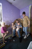 Gloucester, a family at home in their rented house. The property is in very bad condition. - Paul Box - 29-07-2007