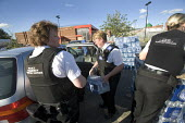Gloucester, Police community support officers put bottles water into cars for people that have no drinking water supplies. - Paul Box - 29-07-2007