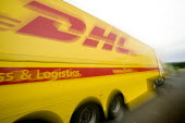 DHL parcel delivery lorry, Bristol. - Paul Box - 2000s,2007,cargo,cities,city,company,courier,COURIERS,deliveries,DELIVERING,delivery,driver,drivers,driving,EBF Economy,freight,HAULAGE,HAULIER,HAULIERS,hgv,hgvs,highway,home,international,job,jobs,LA