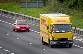 DHL parcel delivery lorry, M4 motorway, Bristol. - Paul Box - 2000s,2007,AUTO,AUTOMOBILE,AUTOMOBILES,AUTOMOTIVE,car,cargo,cars,cities,city,company,courier,COURIERS,deliveries,DELIVERING,delivery,driver,drivers,driving,EBF Economy,freight,HAULAGE,HAULIER,HAULIERS